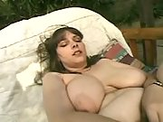 Breasty mom with dildo