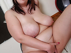 Sex-frenzied plump girl plays with her shaven hole