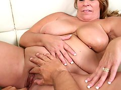 Tanned mature bitch filling her fat hungry mouth with huge cock