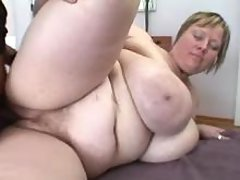Chubby milf sucks hard cock of man