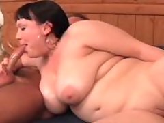 Busty brunette sucks dick