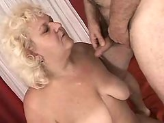 Fat mature gets cum on tits in bed