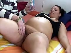 Man caress pregnant brunette in bed