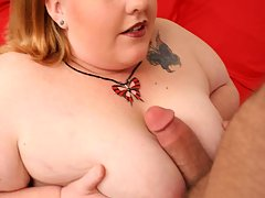 Tattoed plumper squeezing her huge tits while getting fucked