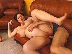 Guy fucks chubby pregnant mature on leather sofa